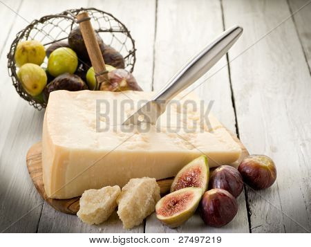 parmesan cheese over cutting board and figs