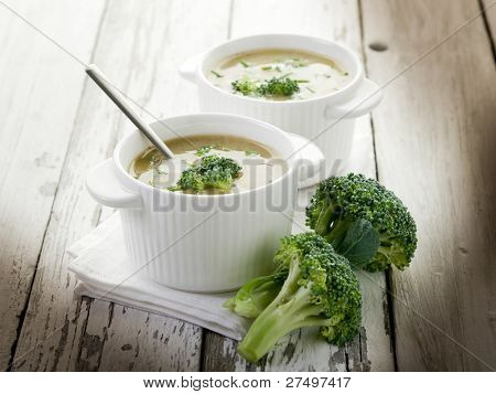 broccoli soup on bowl over wood background