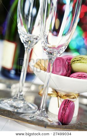 Colorful macaroons and Champagne on Christmass tree background