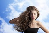 Brunette With Creative Hairstyle In Sky