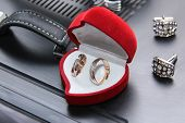 Wedding Rings Of Newlyweds In A Red Box In The Form Of Heart With Cuff Links And Hours Of The Groom. poster