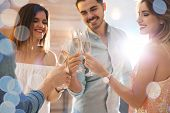 Friends Clinking Glasses With Champagne At Party Indoors poster