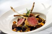 picture of lamb chops  - Image of lamb chops on a bed of vegeables - JPG