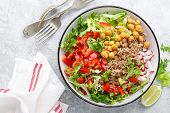 Healthy And Delicious Bowl With Buckwheat And Salad Of Chickpea, Fresh Pepper And Lettuce Leaves. Di poster