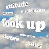 The phrase Look Up and many positive words in 3d letters such as attitude, dream, desire, belief, in