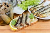 Open Sandwich With Smoked Sprats Preserved In Vegetable Oil And Lemon Slices Against Of Preserved, S poster