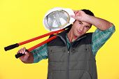 image of transpiration  - Construction worker wiping the sweat from his forehead - JPG