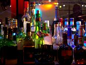 picture of liquor bottle  - Assorted colorful bottles of alcoholic drinks in a night - JPG