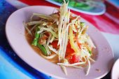 stock photo of thai food  - Thai papaya salad hot and spicy mixed from variety of vegetable closeup also know as Som Tam - JPG