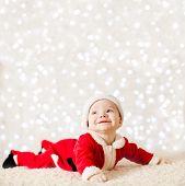 Little Santa Baby Over Defocused Lights Wall poster