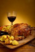 foto of roast chicken  - chicken roasted with potatoes on wood background - JPG