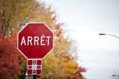 Quebec Stop Sign, Obeying By Bilingual Rules Of The Province Imposing The Use Of French Language On  poster