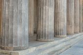 Ancient pillars and steps of grey marble, ionic rhythm. Historic heritage, close up view with detail poster