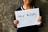 Girl With Stop Bullying Sign, Stop Bullying Concept. Bullying Is Unwanted And Aggressive Behavior. I poster