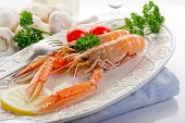 foto of norway lobster  - norway lobster with tomatoes and lemon on dish - JPG