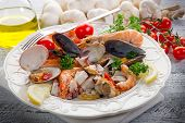 stock photo of norway lobster  - sea salad on dish - JPG