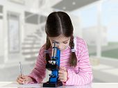 picture of retort  - little girl looking with microscope in school laboratory - JPG