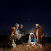 stock photo of nativity  - Christmas nativity scene with three Wise Men presenting gifts to baby Jesus Mary  - JPG
