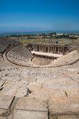 Roman amphitheatre in the ruins of Hierapolis, in Pamukkale, near modern turkey city Denizli, Turkey poster