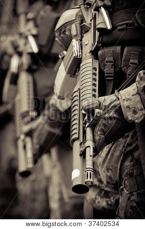 soldier in formation with armo assault rifle