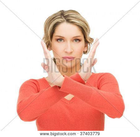 bright picture of young woman making stop gesture..