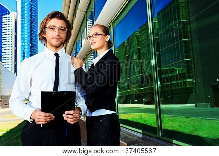 Business people standing in a big city over modern buildings.