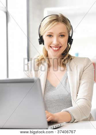 picture of helpline operator with laptop computer.