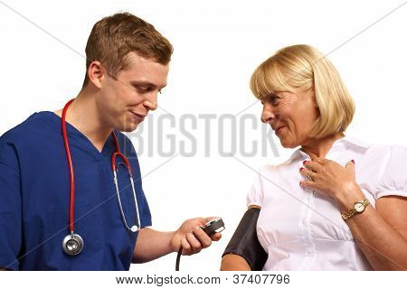 Doctor Taking Blood Pressure Of Mature Female Patient