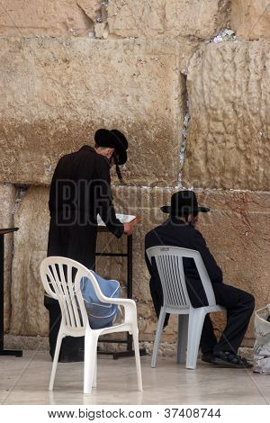 JERUSALEM - OCTOBER 03: Unidentified Jewish men pray at the western wall October 03, 2006 in Jerusalem, IL. The wall is one of the holiest sites in Judaism attracting thousands of worshipers daily.