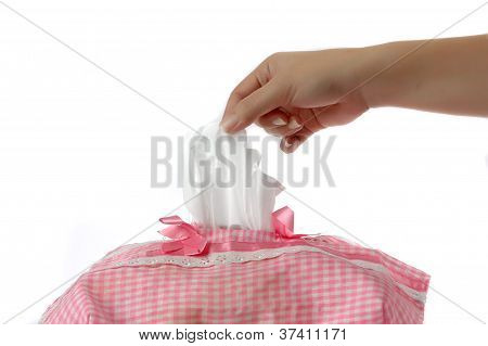 Woman's Hand Taking A Piece Of Tissue Paper