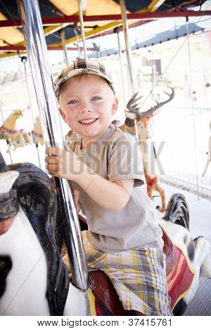 Little Boy on a Carnival Carousel