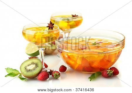 punch in bowl and glasses with fruits, isolated on white
