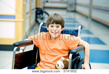 Little Boy In Wheelchair