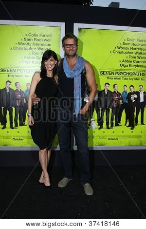 "LOS ANGELES - OCT 30:  Perrey Reeves, Johann Urb  at the ""Seven Psychopaths"" Premiere at Bruin Theater on October 30, 2012 in Westwood, CA"