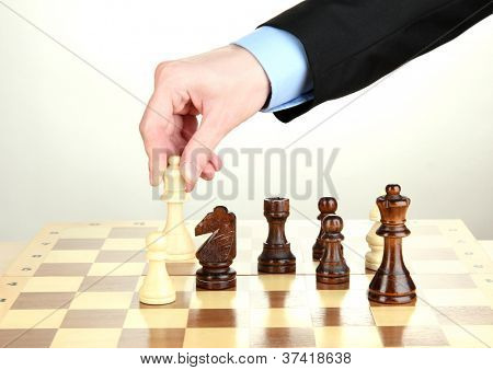 businessman playing chess isolated on white