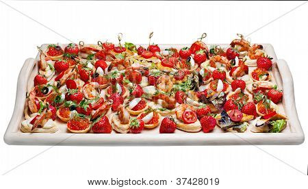 Lot Of Canape With  Shrimp, Caviar, Strawberries And Other On Wooden Tray Isolated On White Backgrou