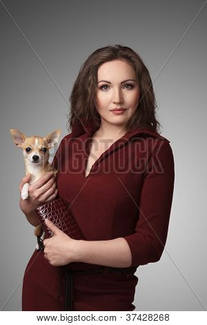 Caucasian Young Woman With Chihuahua Puppy