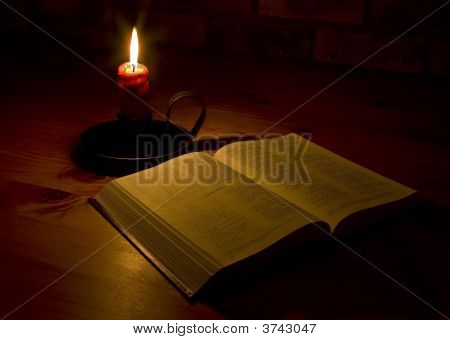 Open Bible By Candle Light