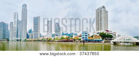 Singapore River Quay With Skyscrappers And Restaurants