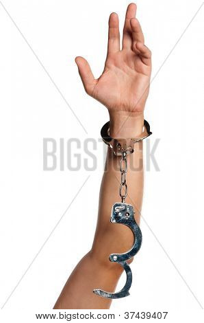 Man hand with handcuffs isolated on white background