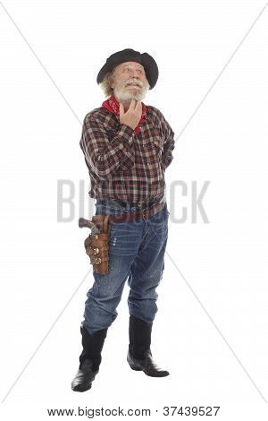 Old West Cowboy Stands Scratching His Beard