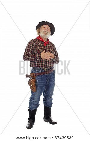 Proud Old West Cowboy Stands With Hands Clasped