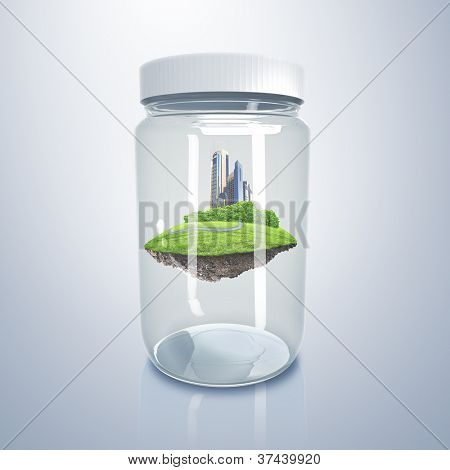 Green city on the hill inside a glass jar