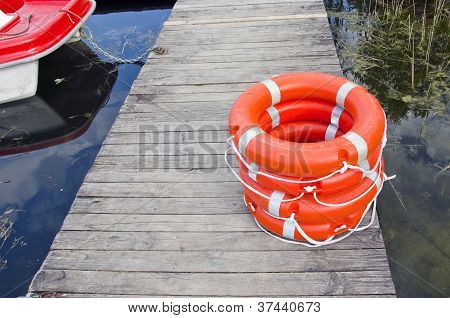 Life Buoy On Wooden Resort Lake Bridge