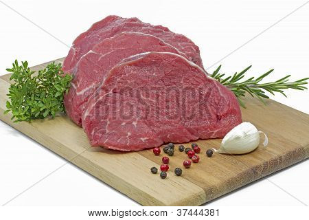 Beef fillet on a wooden plate
