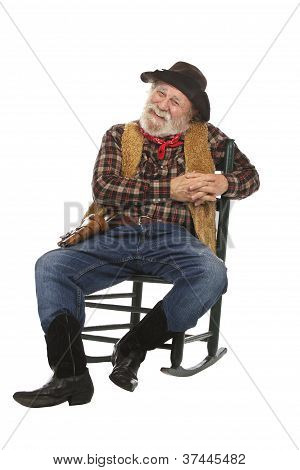 Happy Old Cowboy Sits In Rocking Chair