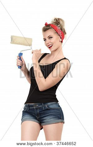 Young Woman Painting Wall