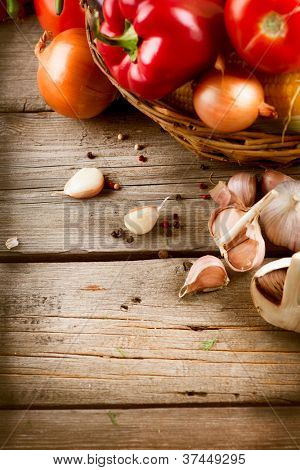 Vegetables on a Wooden Background. Art Border Design . Healthy Organic Vegan Food