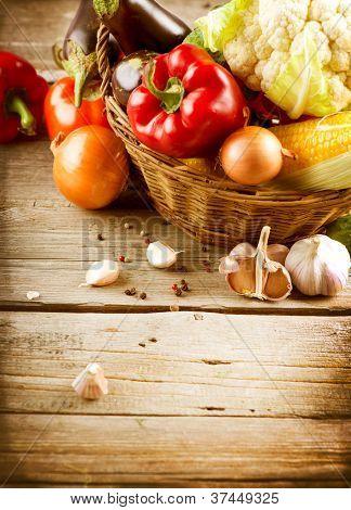 Healthy Organic Vegetables on a Wooden Background. Art Border Design