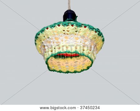 Knitted lampshade for electric light bulbs